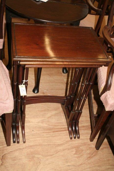 607: A nest of three mahogany tables
