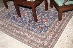 764: A Kuba blue ground rug, 4ft 7ins x 6ft 3ins