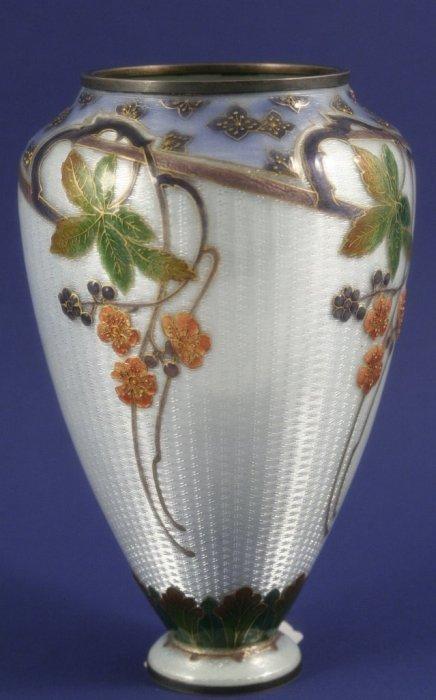 1009: A French Art Nouveau silver mounted enamel vase,