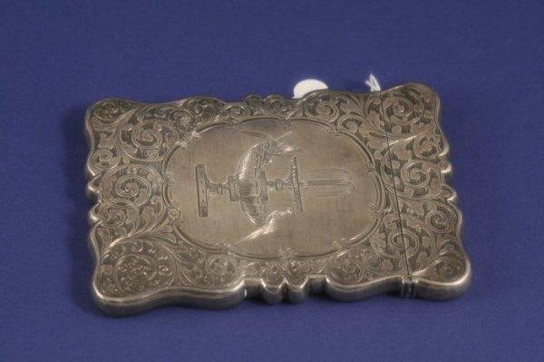 1025: A Victorian serpentine silver card case, 4ins