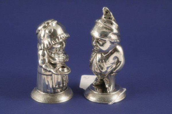 1028: A pair of Victorian novelty silver pepperettes mo