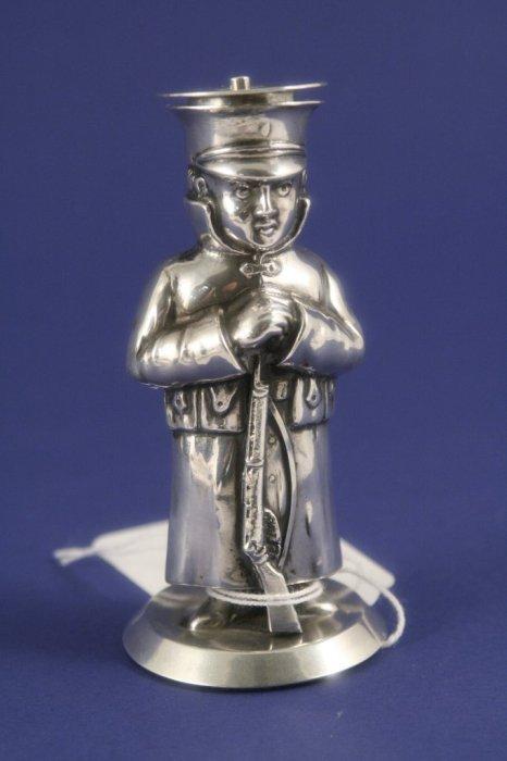 1029: An Edwardian silver salt modelled as a world war