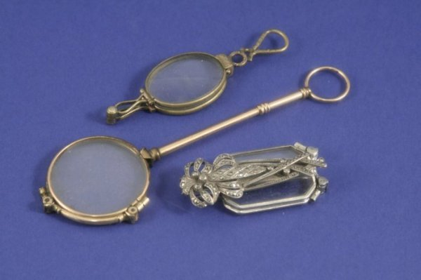 1031: A pair of gold lorgnettes and two other lorgnette