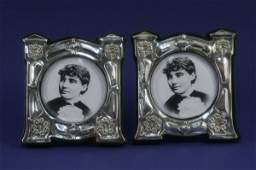 1191 A pair of Edwardian Art Nouveau silver mounted ph