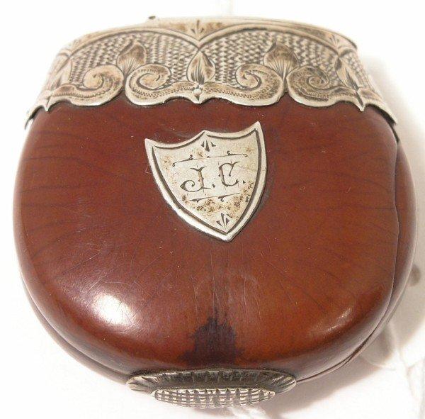 1335: A 19th century silver mounted coquilla nut vesta,