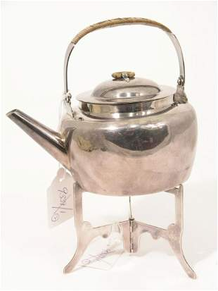 A 19th century silver plated picnic teapot in the