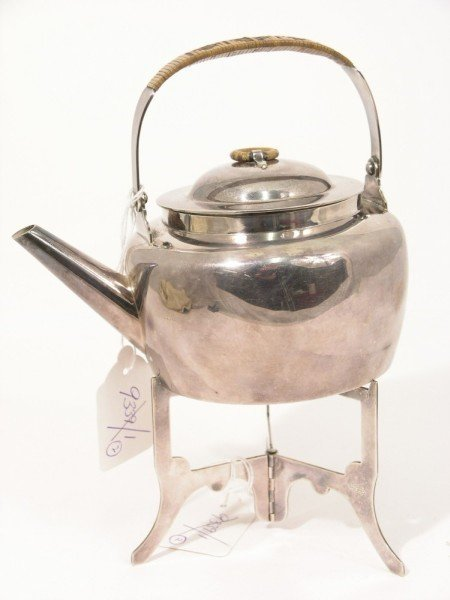 1342: A 19th century silver plated picnic teapot in the