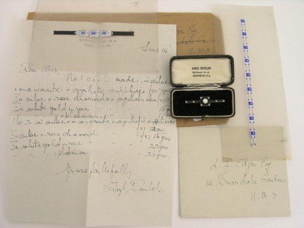 1732: A Sibyl Dunlop bar brooch & associated items