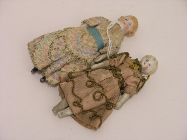 1: A late 19th century German miniature doll, 4ins
