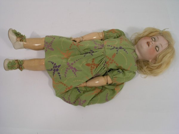 2: An Armand Marseille bisque doll, 21in.