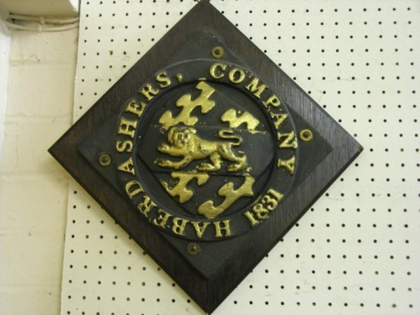 16: A cast metal Haberdashers Company wall plaque, 11in
