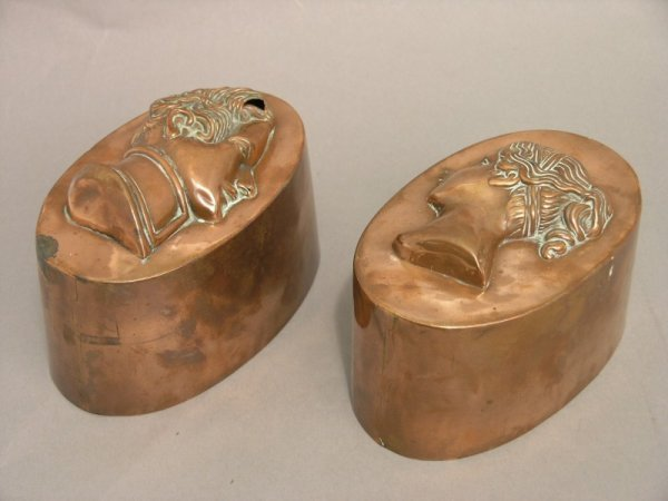 330: A pair of Victoria and Albert copper jelly moulds,