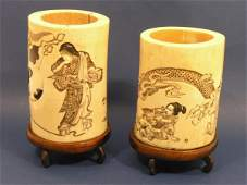 616: A pair of late 19th century Japanese carved ivory