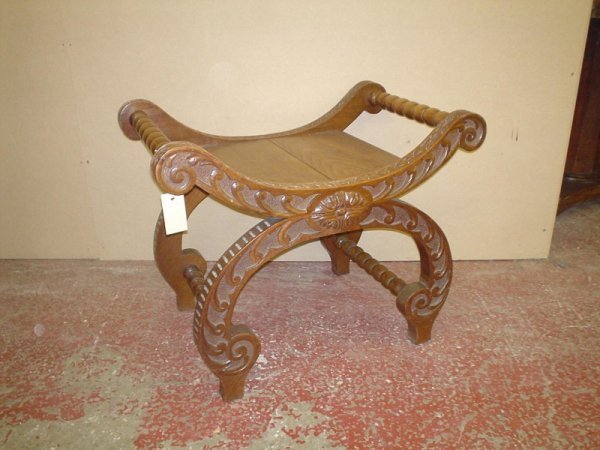 823: A Continental carved walnut 'X' frame stool, 2ft