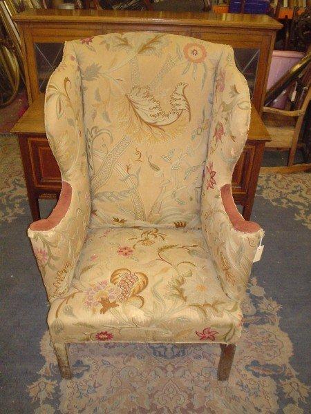 824: A George III design mahogany wing back armchair,