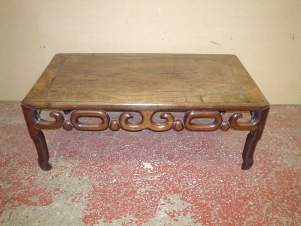 825: A Chinese carved hardwood opium table, 2ft 6ins