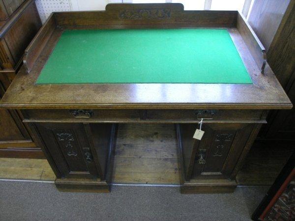 831: A secessionist carved oak pedestal desk, 3ft 8ins