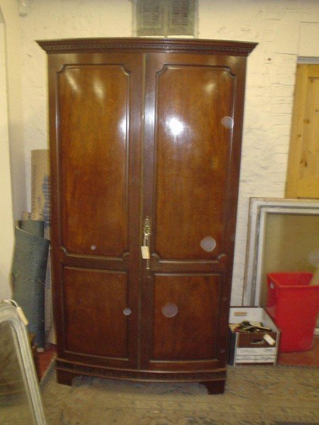 834: A Victorian bow fronted wardrobe, 6ft 8ins