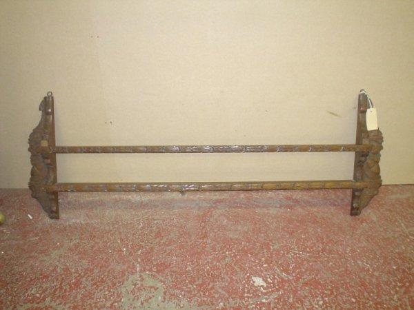 835: A carved oak two shelf hanging plate rack, 4ft