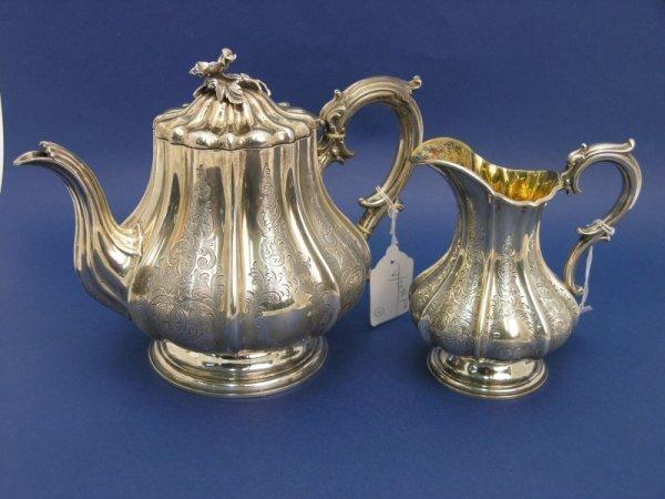 1249: A Victorian silver pedestal teapot, & matching cr