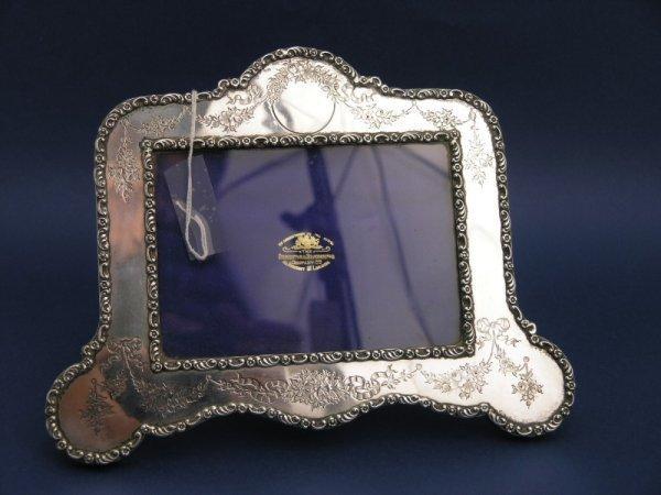 1250: An Edwardian silver photograph frame, aperture 5.
