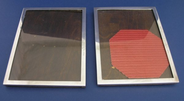 1251: A pair of George VI silver photograph frames, 8.7