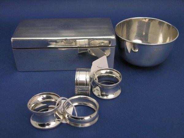 1253: A George V silver cigarette case, sugar bowl and