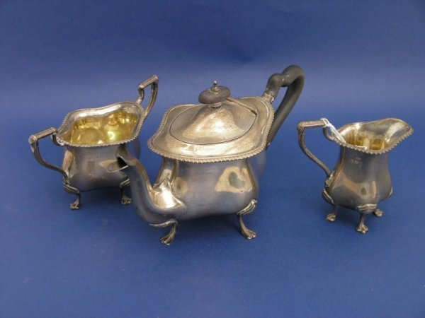 1255: An Edwardian silver bachelor's tea set, gross 22o