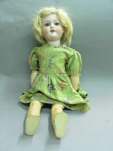 1: An Armand Marseille bisque doll, 21in. - chipped sec
