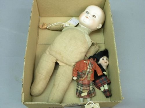 2: A bisque doll with cloth body and two small Highland