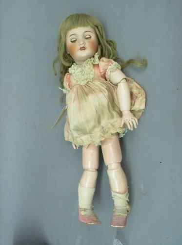 4: A Jumeau bisque doll, 20in.