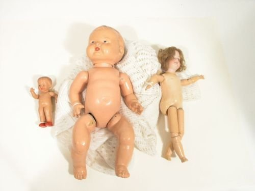 13: An Armand Marseille bisque doll and two composition