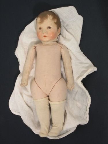 14: A Kathe Kruse doll, 14in.