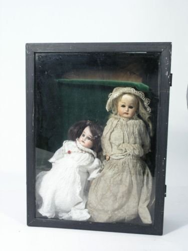 16: An Armand Marseille bisque doll and a composition d