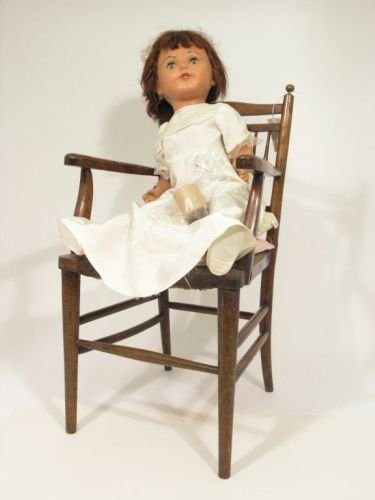 19: A composition doll, some worm to chair's underframe