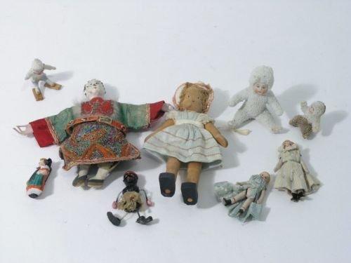 20: Nine various miniature dolls