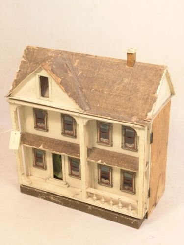 22: A Lines Bros. cream painted dolls house, 21.25in. w