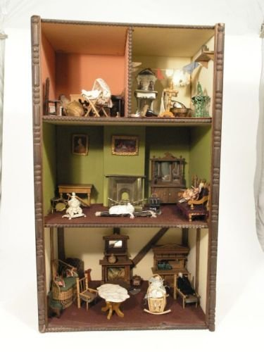 24: A doll's house display, 17.75in. wide; 30in. high