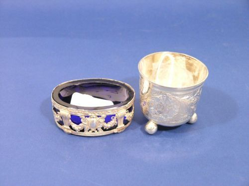 A silver beaker and oval salt