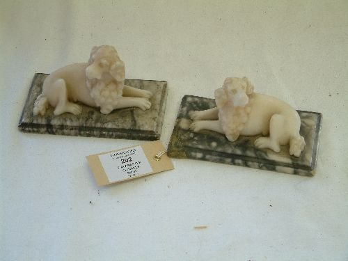 202: A pair of carved alabaster figures of seated spani