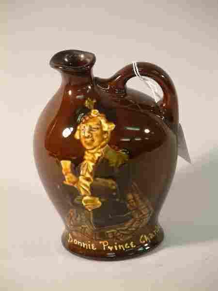498: A Royal Doulton Kingsware Dewars Whisky flagon - B