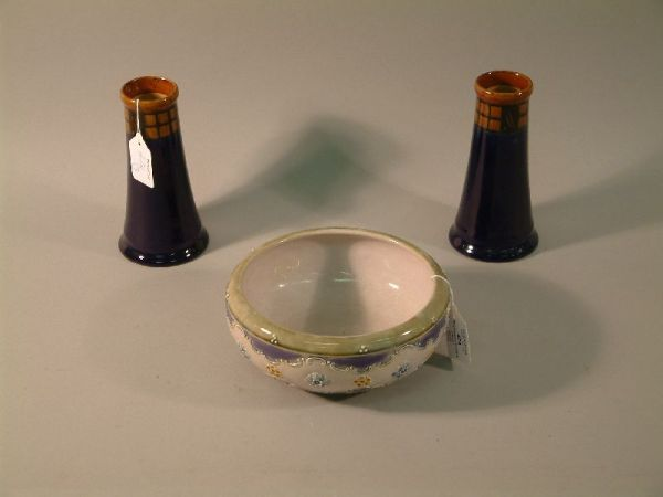 504: A pair of Royal Doulton blue glazed tapered cylind
