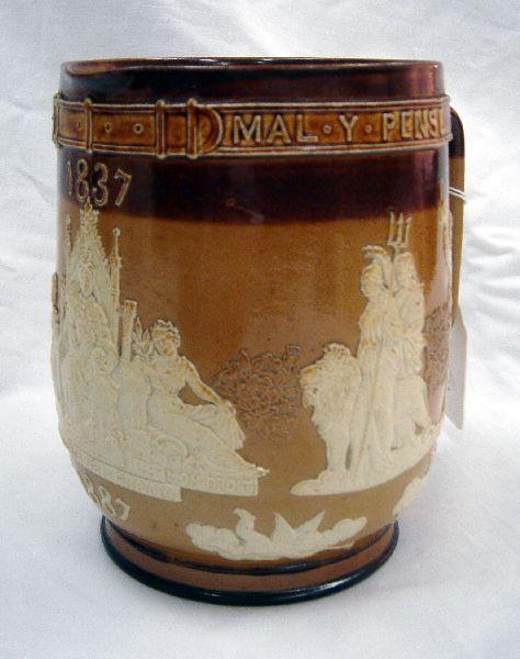 509: A Doulton Lambeth stoneware 1887 Royal Jubilee jug