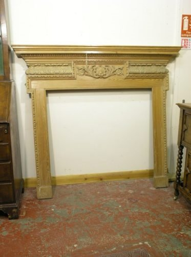 567: A late 19th/early 20th century carved pine fire su