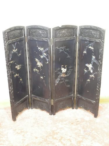 566: A late 19th century ebonised carved wood four fold