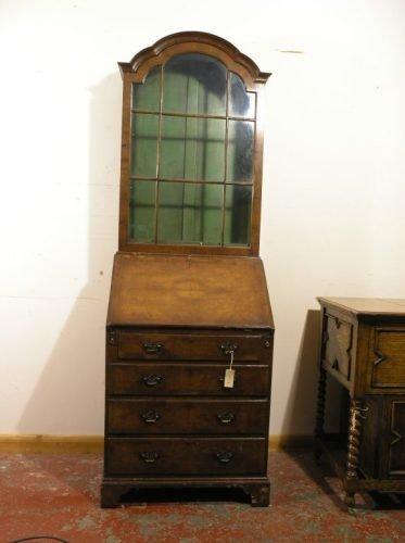 559: A 1930's walnut bureau bookcase