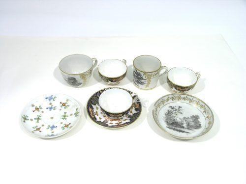 320: An English porcelain trio, three Derby cups, sauce