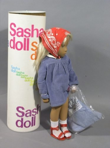 14: A Sasha blonde girl doll, in clothing and original
