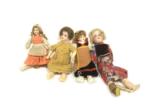 11: An Armand Marseille bisque doll and three other sma