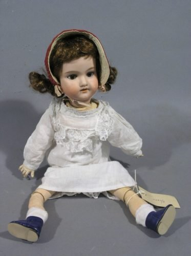 3: An Armand Marseille bisque doll, 18in.